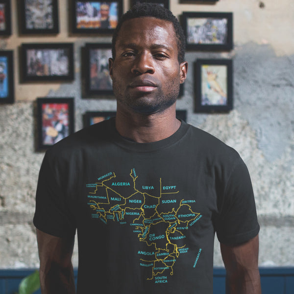 Africa Map Minimalist T-shirt, African American man wearing a shirt featuring Africa and the names of the African countries.