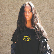 "Female Model in ""Third Culture Kid"" Black T-Shirt"