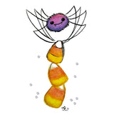 cute purple spider standing on candy corn with Swarovski crystals
