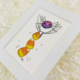 cute cartoon spider on a stack of candy corn art print with white matte