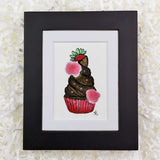 Chocolate fudge frosting cupcake with a strawberry on top, art print with black frame