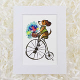 penny farthing bike with a dog wearing a vest, art print with a white matte