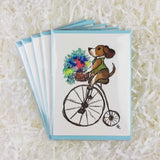 cute dog with a green vest on a bike with a basket of flowers set of 5 handmade cards