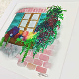 Pretty flowers on a window sill with blue shutters on a brick wall art print with white matte
