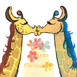 Closeup detail of kissing giraffes with 3D rainbow flowers on a cake