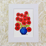 bright red bunch of daisies in a royal blue vase art print with white matte