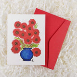 pretty red bouquet of daisies in a round blue vase handmade card with envelope