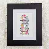 colorful stack of teacups with flowers art print with black frame