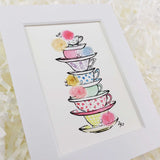 a stack of cute and colorful teacups with roses art print with white matte