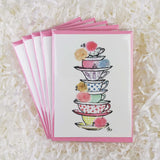 A stack of bright and cute teacups with roses set of five handmade cards
