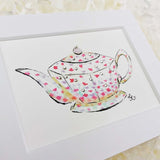 white teapot with small pink and purple scattered flowers art print with white matte