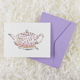 small pink and purple flowers on a white teapot handmade card with envelope