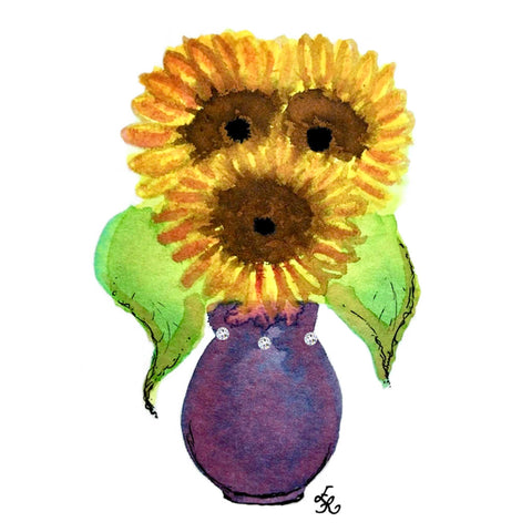 yellow sunflowers in a large purple vase with Swarovski crystals