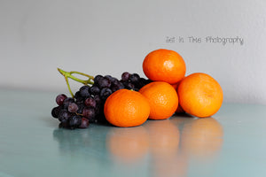 Fresh Grapes And Oranges