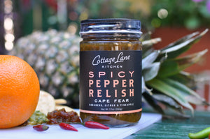 Cape Fear Spicy Pepper Relish 12oz bottle with fruit display