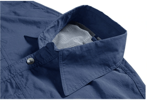 The collar of a navy blue fishing shirt.
