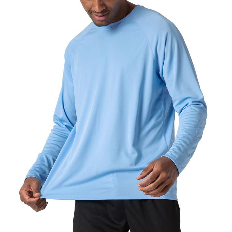 Male model wearing a sky blue, long sleeve t-shirt for sun protection.