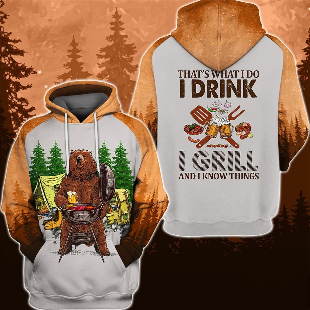 Camping bear hoodie. The bear drinking bear says I drink , I grill and I know things. Brown and white forest colours.