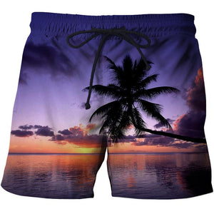 Men's tropical beach shorts with a palm tree over water and a purple sun setting design.