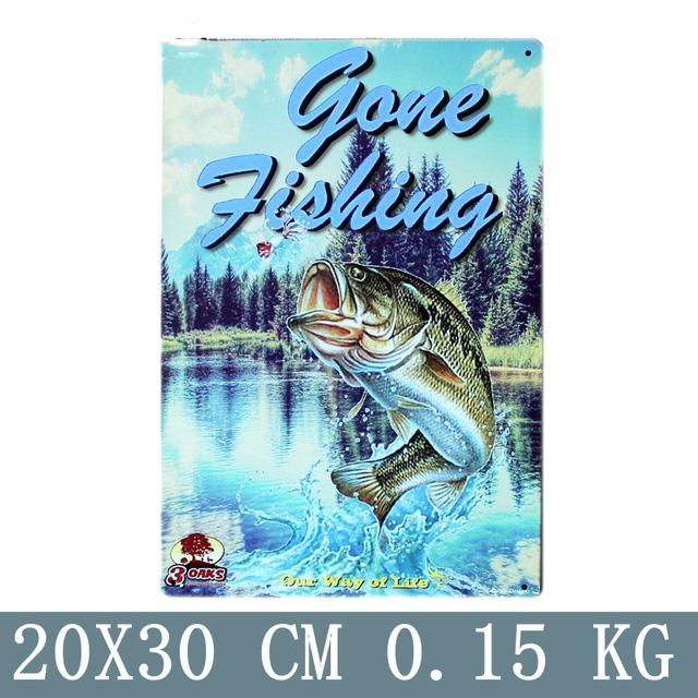Vintage gone fishing sign made from tin metal.