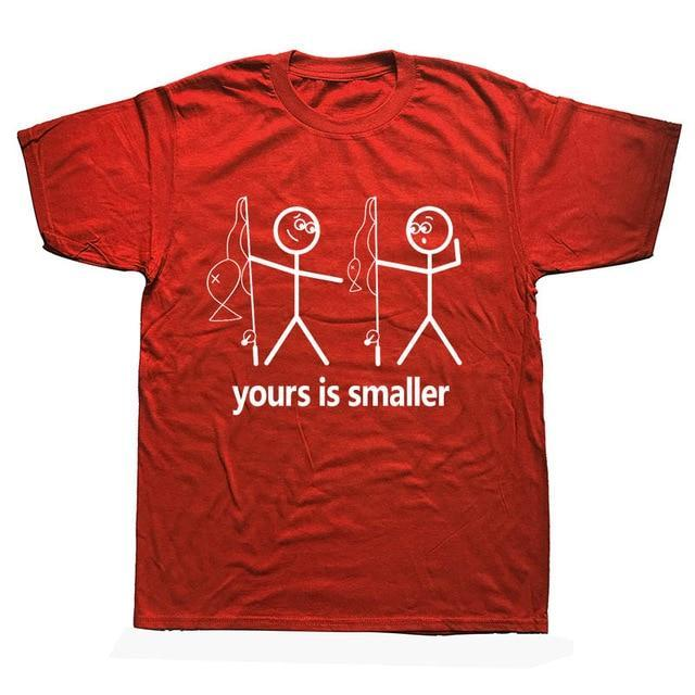Funny fishing t-shirt saying yours is smaller. Red t-shirt with two white stick men holding fishing rods. One is pointing down at the other saying yours is smaller in terms of the fish or other parts of the body.