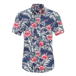 A photo of a men's Hawaiian shirt on a white background. The shirt is blue and has a red hibiscus flower deign and a pocket on the chest.