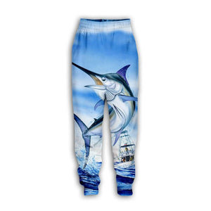 Marlin fishing pants. Blue marlin jumping with fishing boat in background.