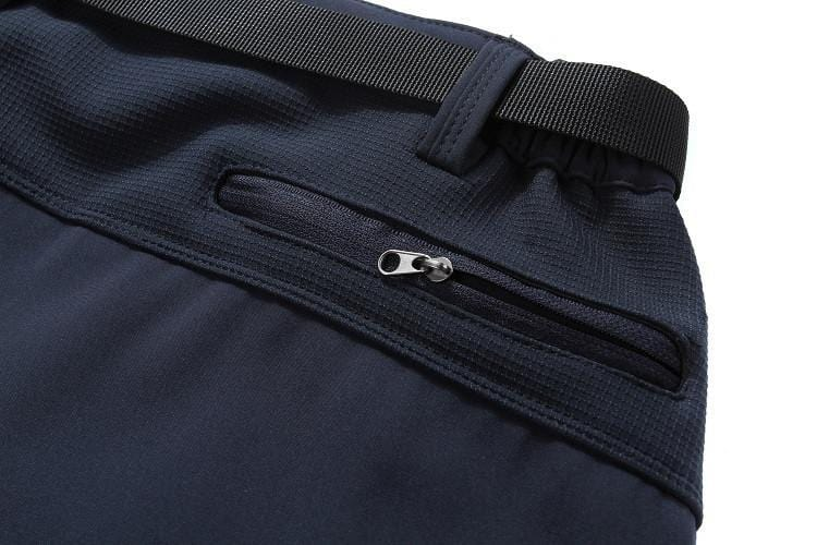 Zip up pocket on the back of mens fishing pants.