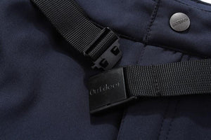 Close up view of waterproof fishing pants zip and buckle.