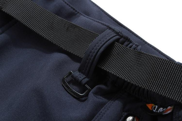 Belt going through belt loop on fishing pants.