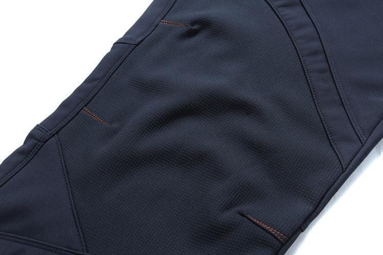 Knee fabric of mens blue fishing pants.