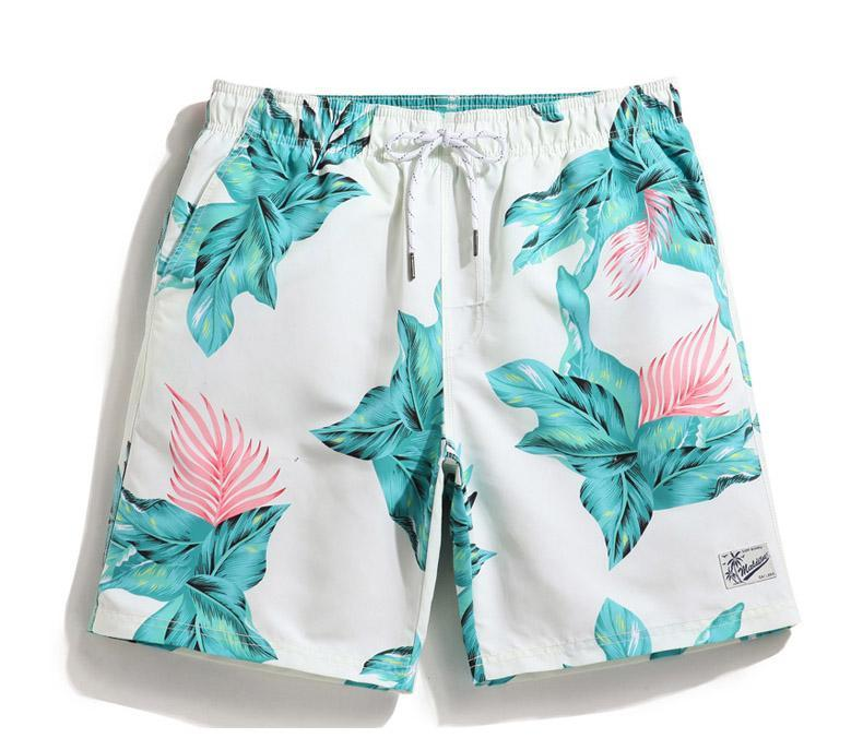 Men's floral print board shorts. White with green flowers. Quick drying.