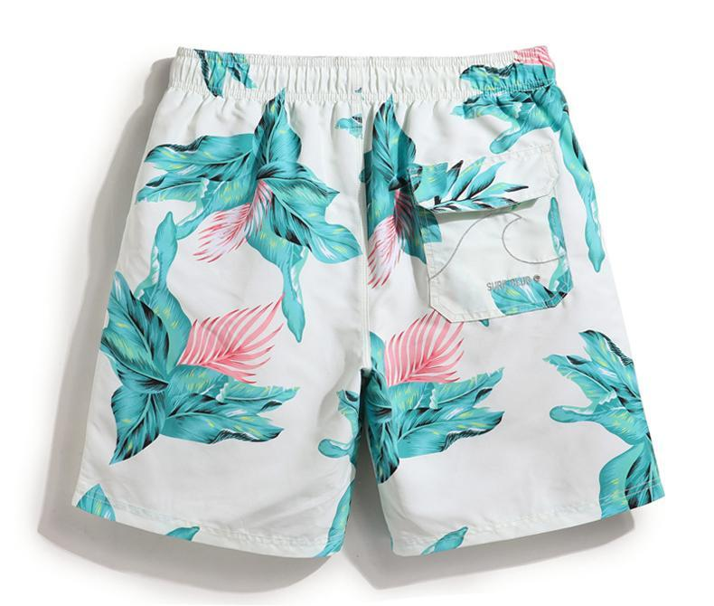 Men's floral print board shorts. White with green tropical flowers. Quick drying.