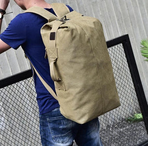 Male model standing wearing the canvas rucksack.