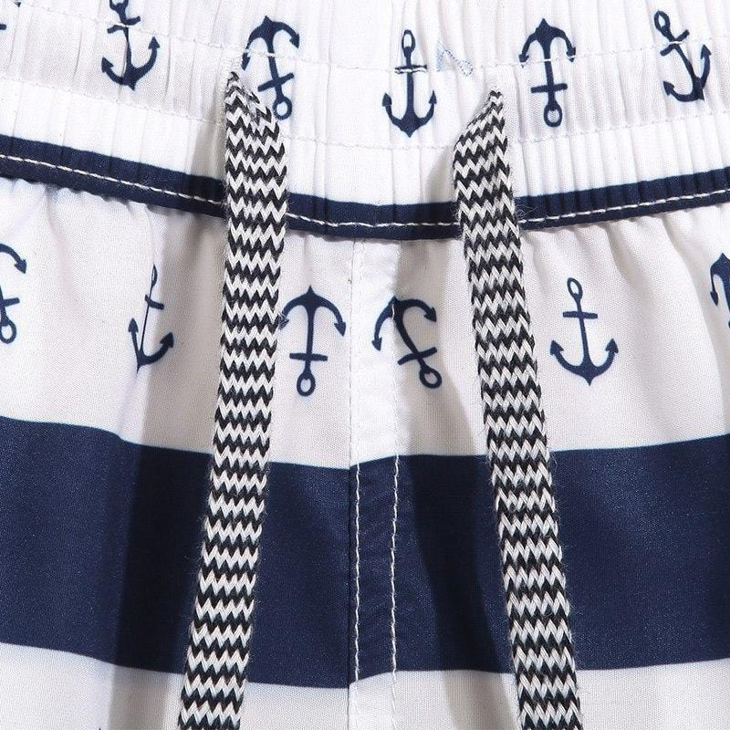 draw string beach shorts with anchor print in blue and white strip.