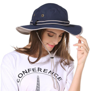 Girl wearing the navy Fisher hat from Guts Fishing Apparel