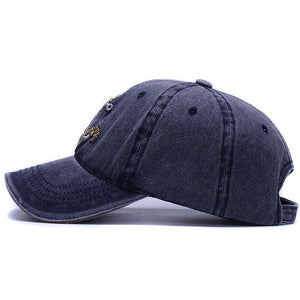 The Washed Anchor cap in navy blue side profile image. Hats for boating and fishing at Guts Fishing Apparel.