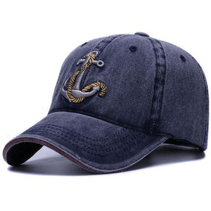 Navy baseball cap with an embroidered anchor and rope design. Get yours today at Guts Fishing Apparel.