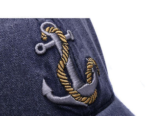 Men's hat with anchor and rope design.