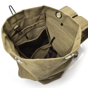 Inside view of the Khaki Canvas Rucksack with three internal pockets and d-ring.