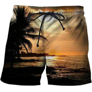 Men's tropical shorts with a golden sun set over tropical beach design.