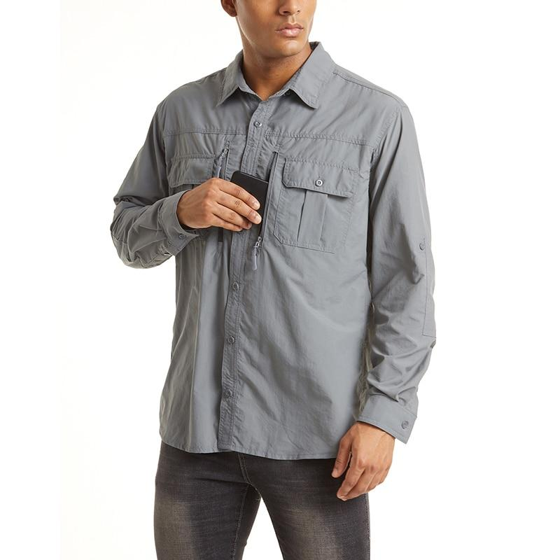 Male model wearing a grey long sleeve shirt with zip pockets.