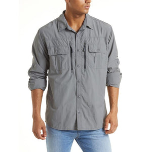 Men's grey button up work shirt. It two zip pockets. Long sleeve.