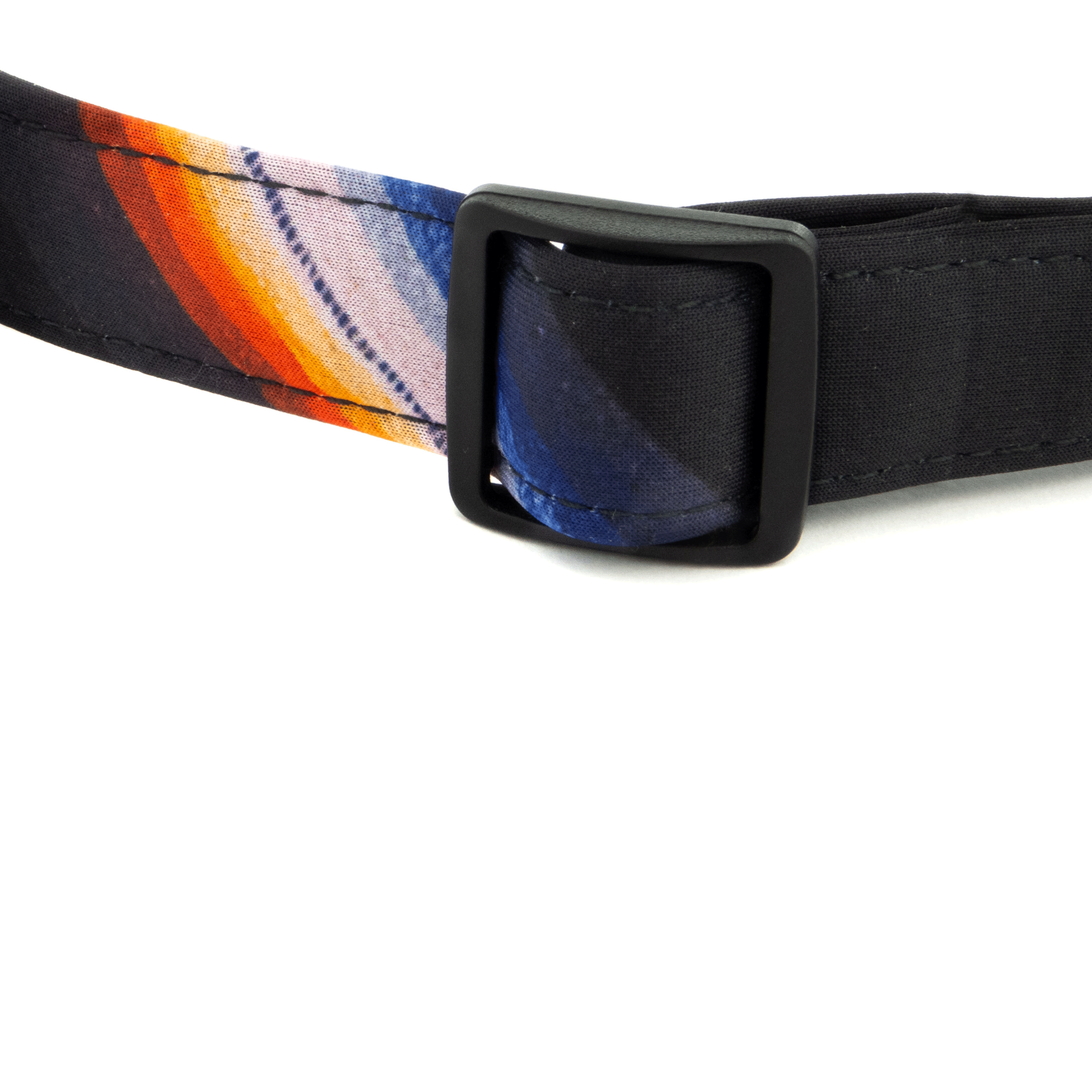 Neoprene close up of Bingin Dog 'Back in Black' dog collar. A solid black print with one blue, orange & white serape stripe detail.