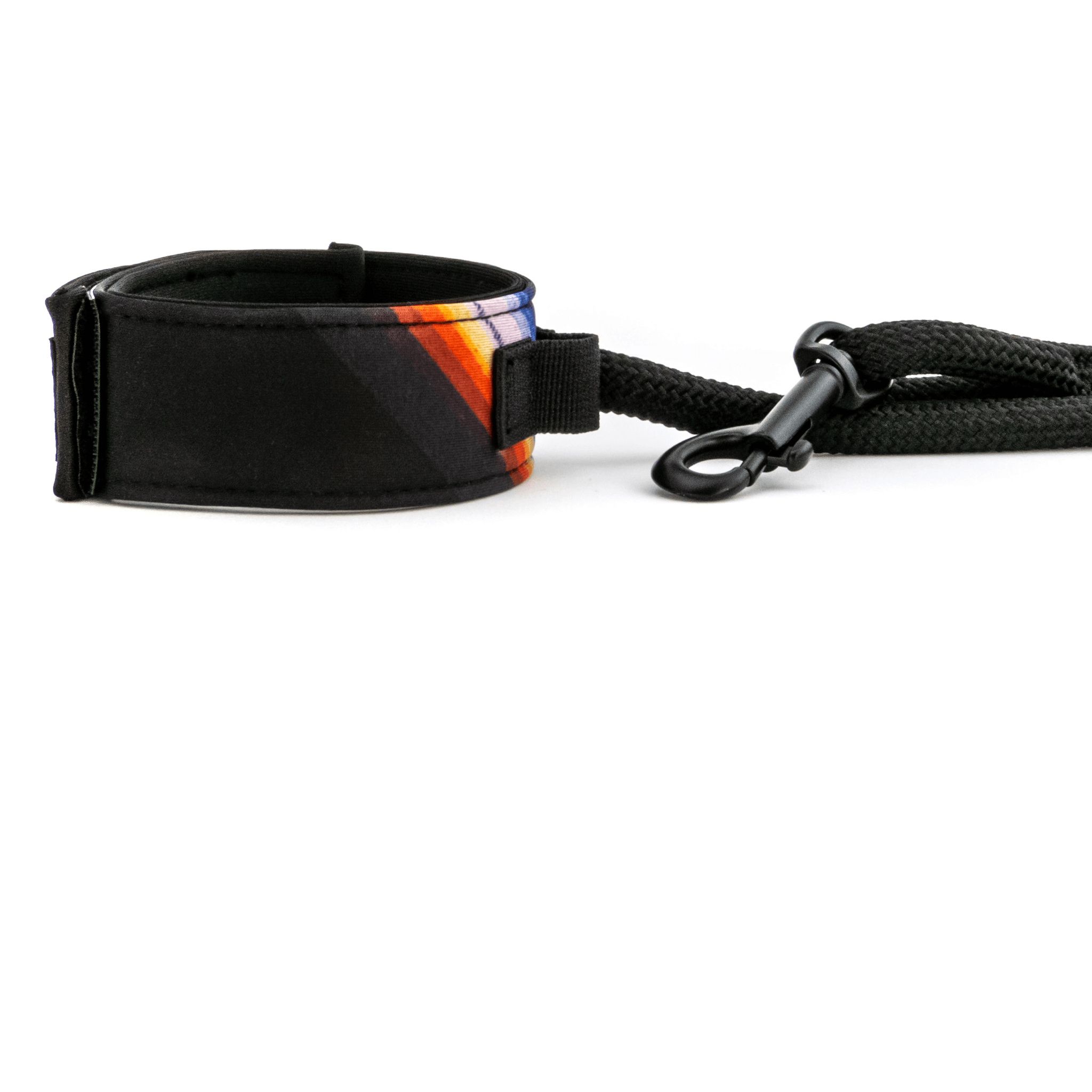 Bingin Dog 'Back in Black' surf-style rope dog leash handle shown from side. Solid black print with one blue, orange & white serape stripe.