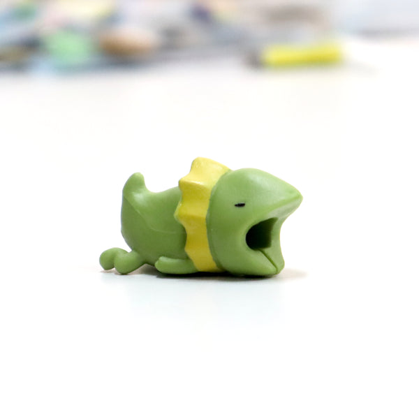 Green toad shaped iphone cable protector