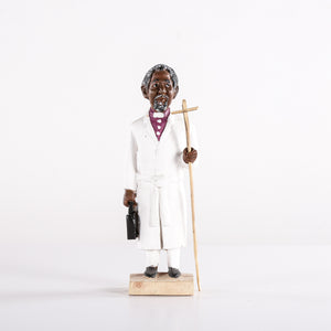 Small Wooden Carving of a Pastor Carrying a Stick and Brief Case