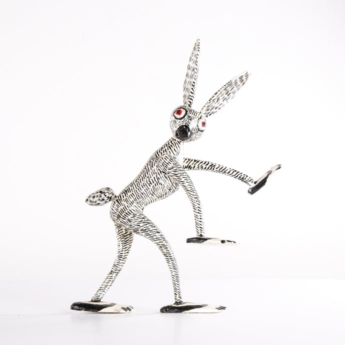 Black and white thin long wooden rabbit