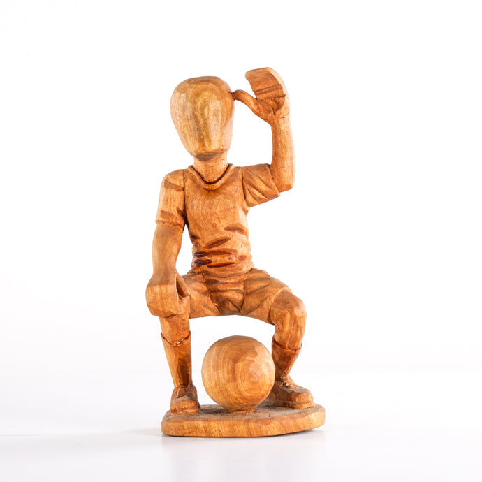 Squatting Footballer Wooden Sculpture
