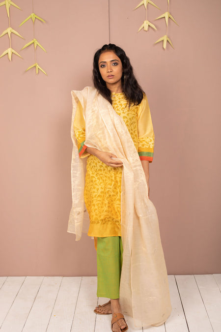 Turmeric yellow saree with chilli flakes and peppercorn dots.
